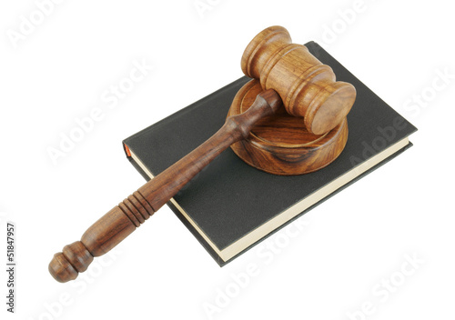Judge's gavel and legal book isolated on white