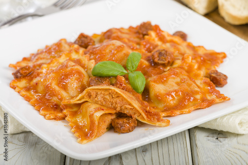 Ravioli filled with chicken & chorizo. Tomato & chorizo sauce.