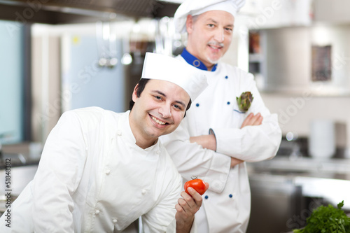 Two chefs in a restaurant's kitchen