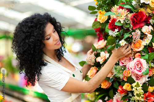 Female florist in a greenhouse