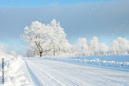 Empty snow covered road in winter - 51848573