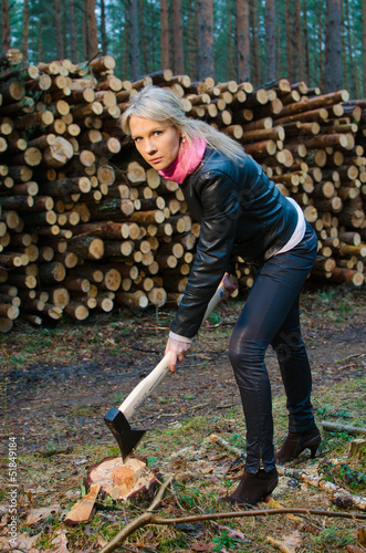 Young pretty woman with big axe