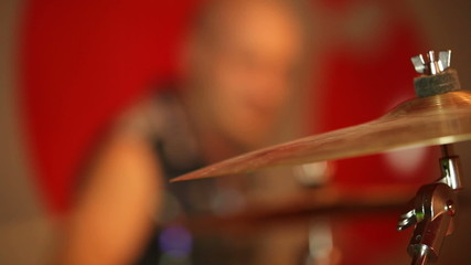 Drum musician playing at a party. Close-up