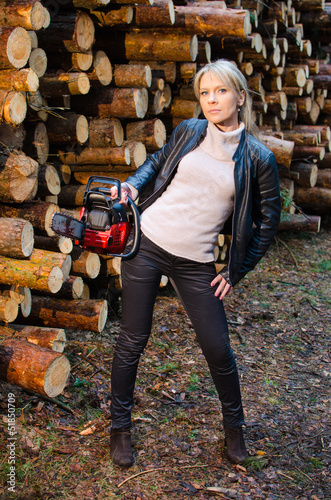 Young pretty woman with red chainsaw