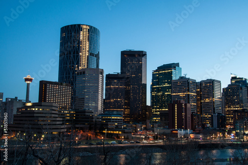 Calgary skyline at dusk, with Bow in foreground.