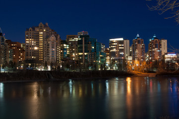 Luxury condos at night along the Bow River in Calgary Alberta