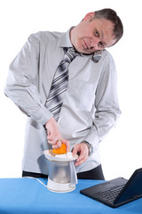 happy businessman make orange juice