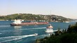Crude oil tanker sailing with a tug boat through Straits