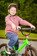Child riding bike with safety helmet outdoors
