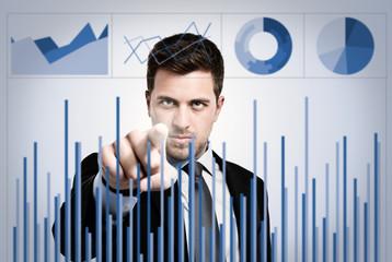 Businessman examining charts
