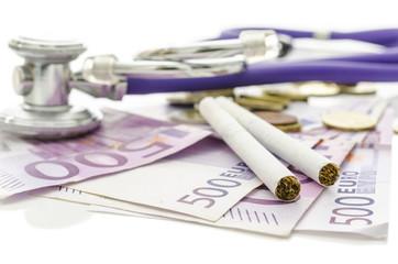Ciarettes and stethoscope on Euro money