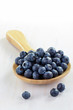 Blueberries in wooden spoon