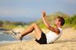 Sit ups - fitness crossfit man doing situps