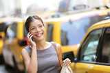 Fototapety Business woman on smart phone in New York City