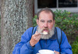 Homeless man eating