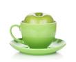 Ripe green apple in tea cup
