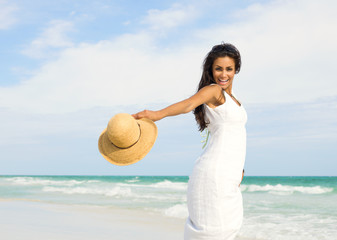 Happy young  woman at the beach