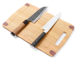 Pair of high quality japanese knifes on cutting board