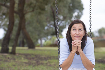 Relaxed happy mature woman park outdoor
