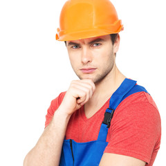 portrait of thinking handyman in uniform