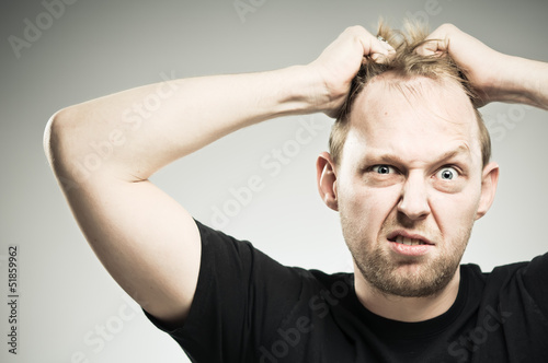 Caucasian Man Pulling Out Hair WIth Frustration