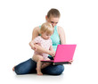 mother and child working at laptop