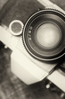 Vintage, old film camera top view. 50mm lens. Sepia