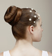 Styling. Woman's Head - Modish Festive Coiffure with Pearls