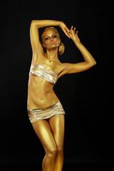 Bright Beauty. Slim Woman with Golden Skin posing. Bodyart