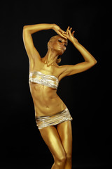 Body Art. Coloring. Woman with Art Gold Makeup. Golden Statue