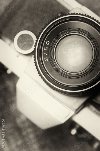 Deurstickers Retro Vintage, old film camera top view. 50mm lens. Sepia