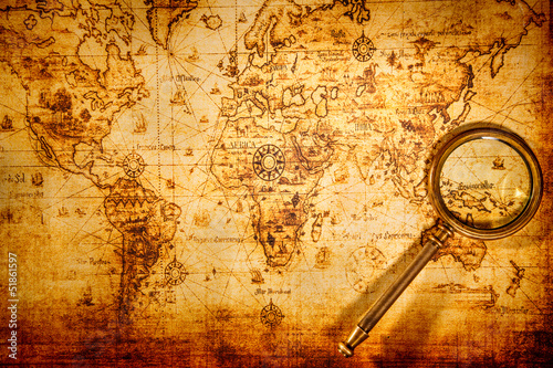 Vintage magnifying glass lies on an ancient world map - 51861597