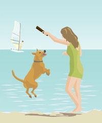 girl playing with a dog by the sea