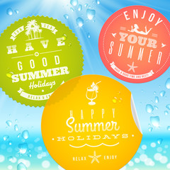 Stickers with vacation and travel emblems on a glass
