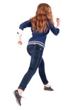 back view of jumping  woman  in  jeans.