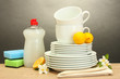 empty clean plates, glasses and cups with dishwashing liquid,