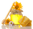 Sweet honey in jar with honeycomb, wooden drizzler and flowers