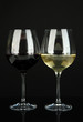 Two glasses of  red and white wine, isolated on black