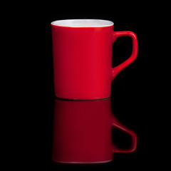 red cup with reflection over black background