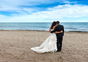 Bride and Groom on the beach next to the Mediterranean Sea