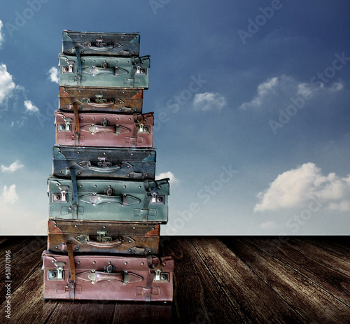 Old travel luggage with nice sky, Retro object