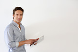 Man standing on white background with tablet