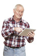 Senior man using tablet computer looking confused