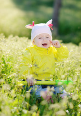 laughing baby in grass