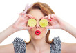 Woman covered her eyes with lemon