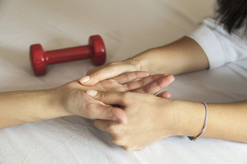 Physical therapist giving a hand massage