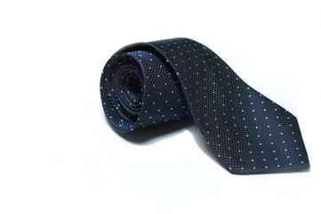 cravatta blu con pois bianchi su sfondo bianco