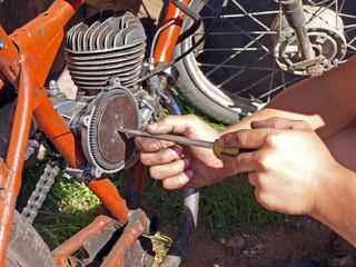 Repairing moped