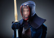 Portrait of kendo fighter with bamboo sword