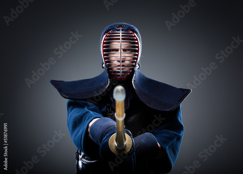Portrait of kendo fighter with bokuto